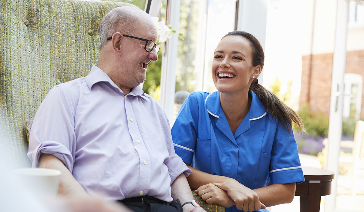 Nurse looking after elderly man