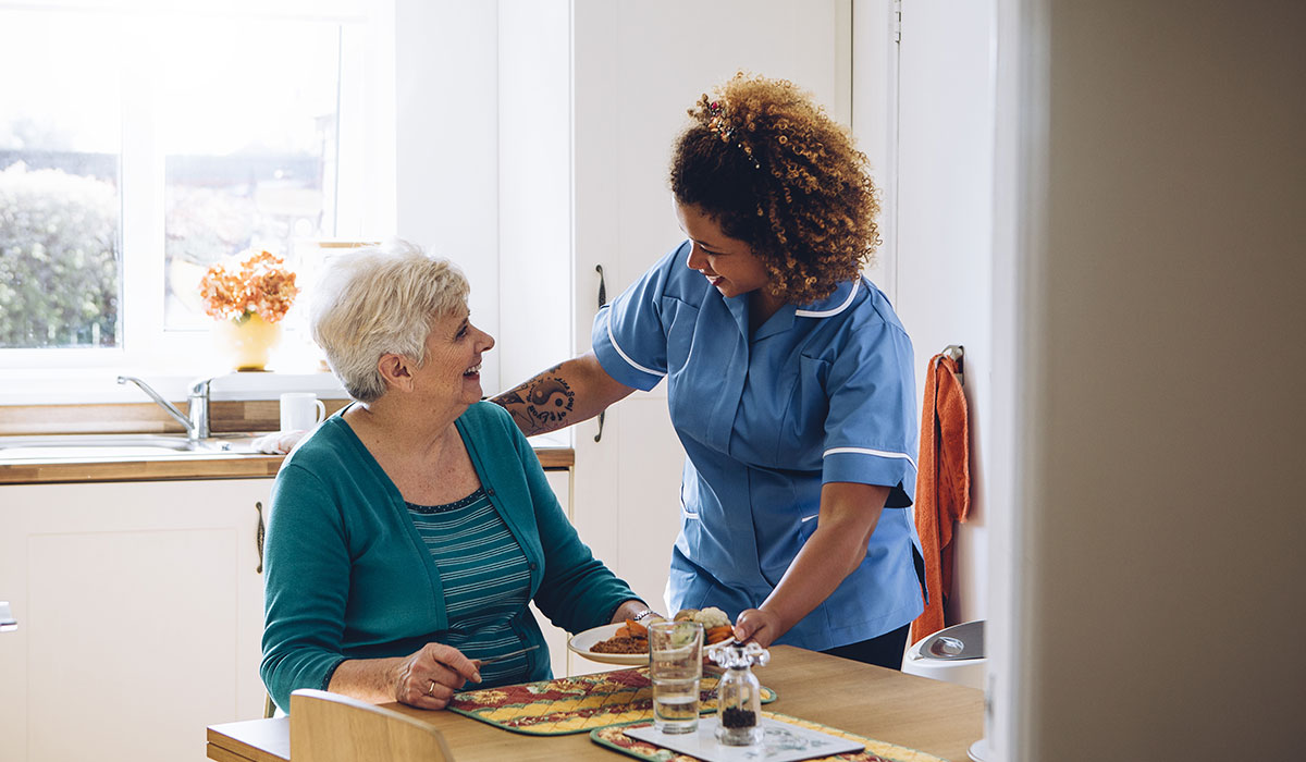 Home carer with patient