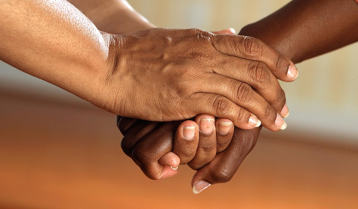 Hands held in caring manner